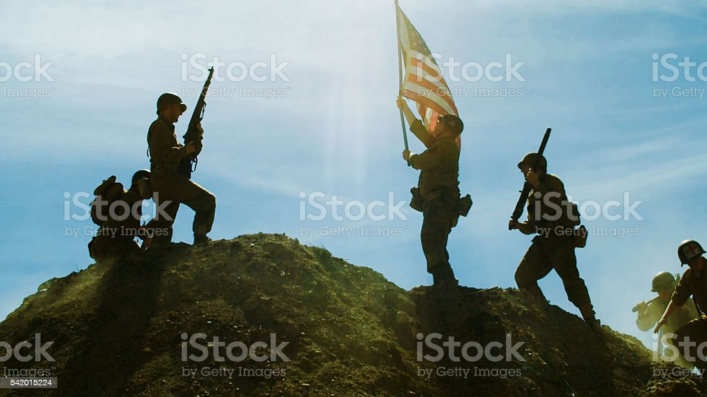 Raising American Flag stock photo