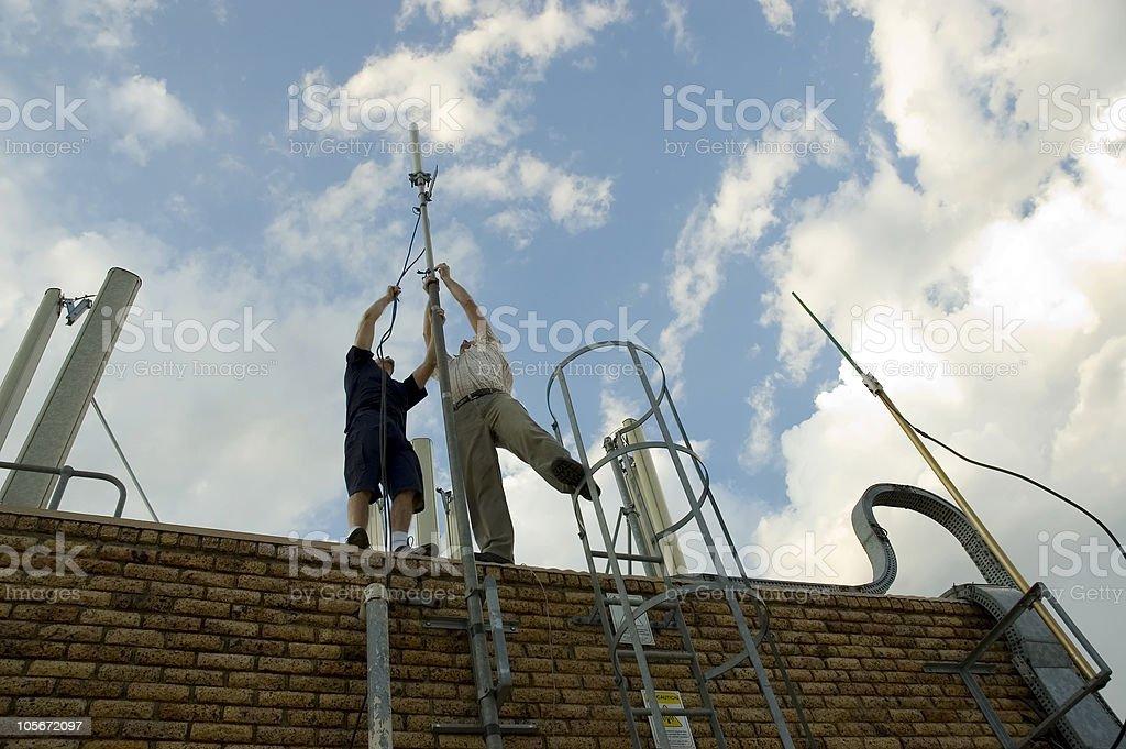 Raising an antenna stock photo
