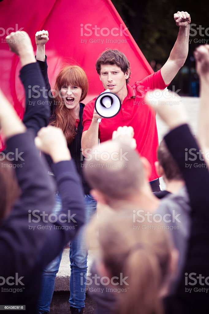 Raising fists to fight for their rights stock photo