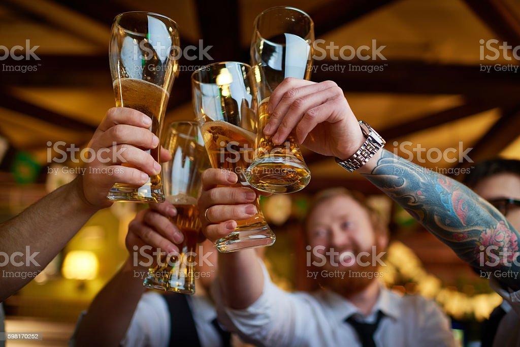 Raising glasses stock photo