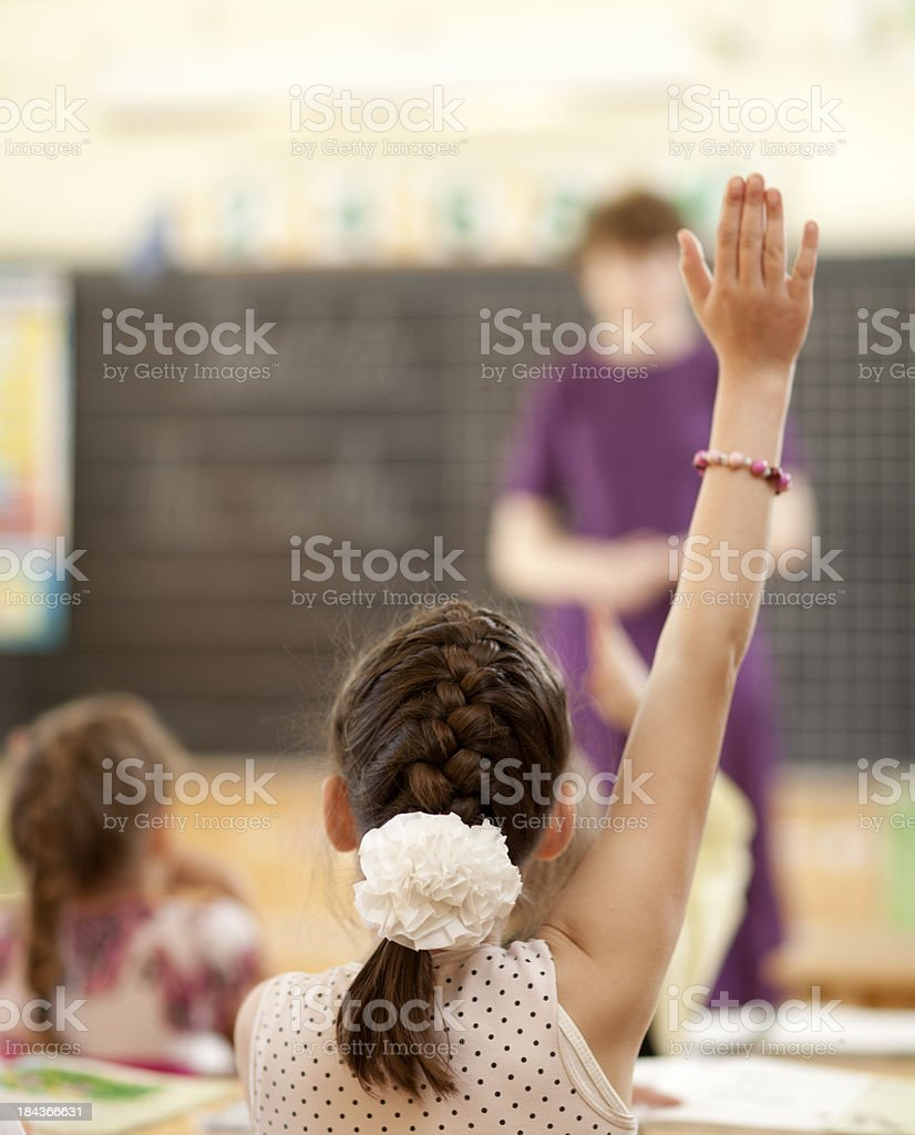 Raising Hands in Elementary Classroom stock photo