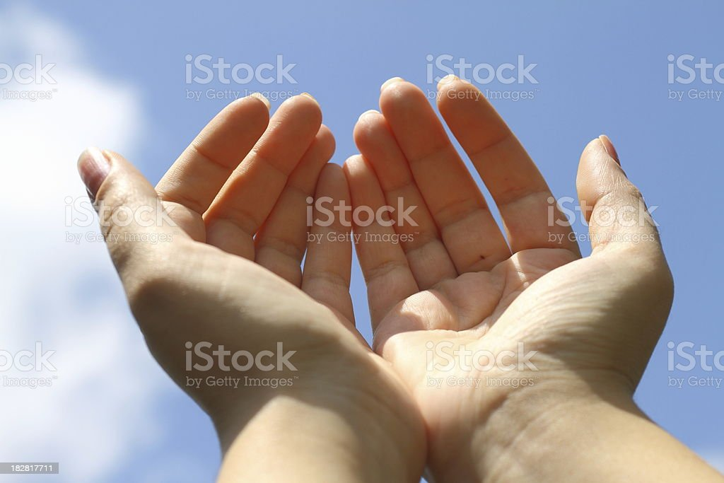 Raising hands towards sky stock photo