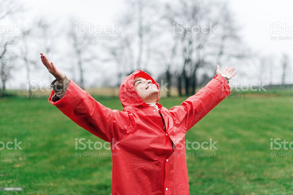 Raising her arms stock photo