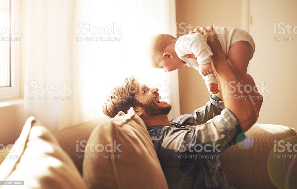 Raising his daughter with so much love stock photo