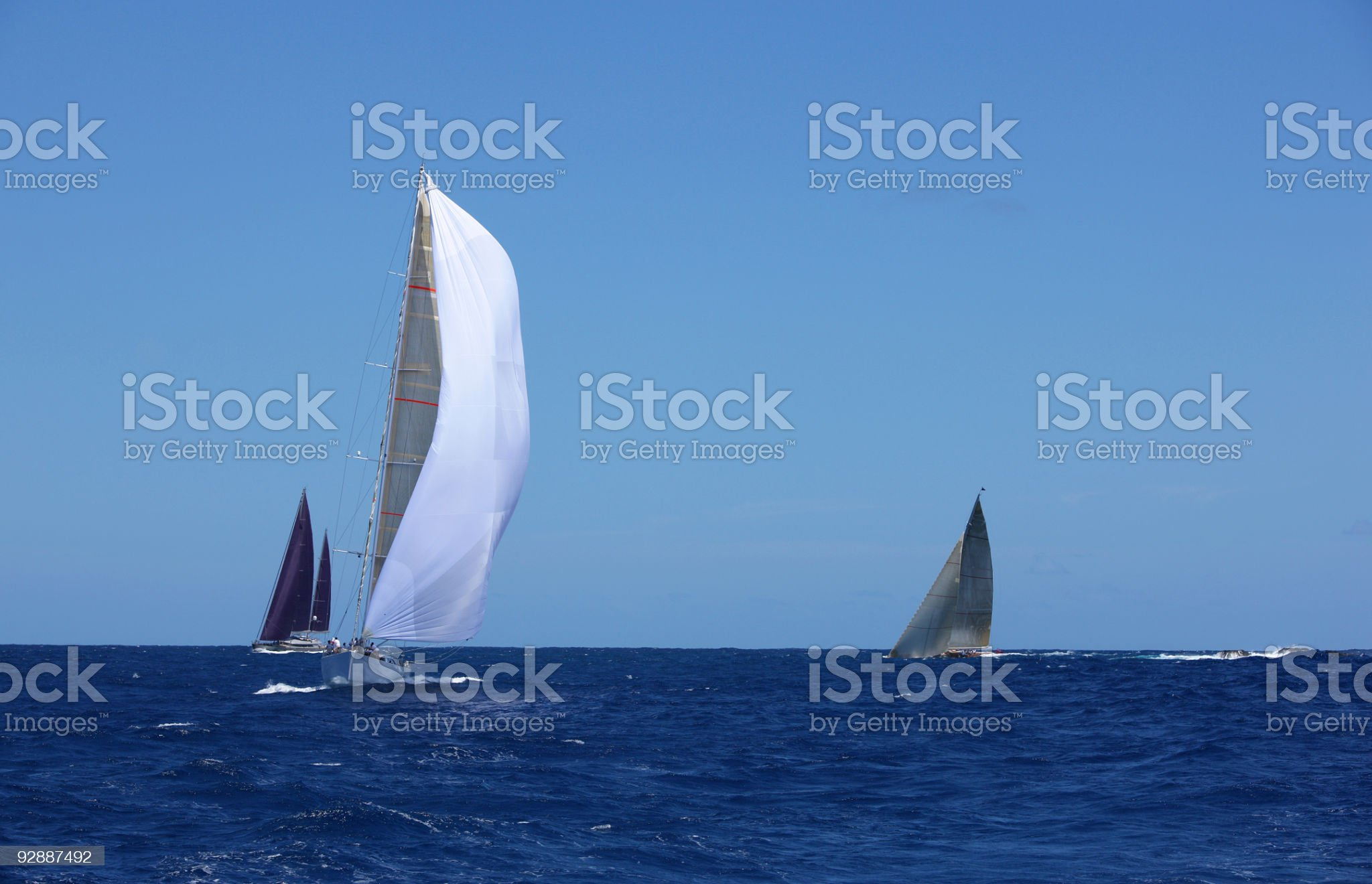 Raising spinnakers. royalty-free stock photo