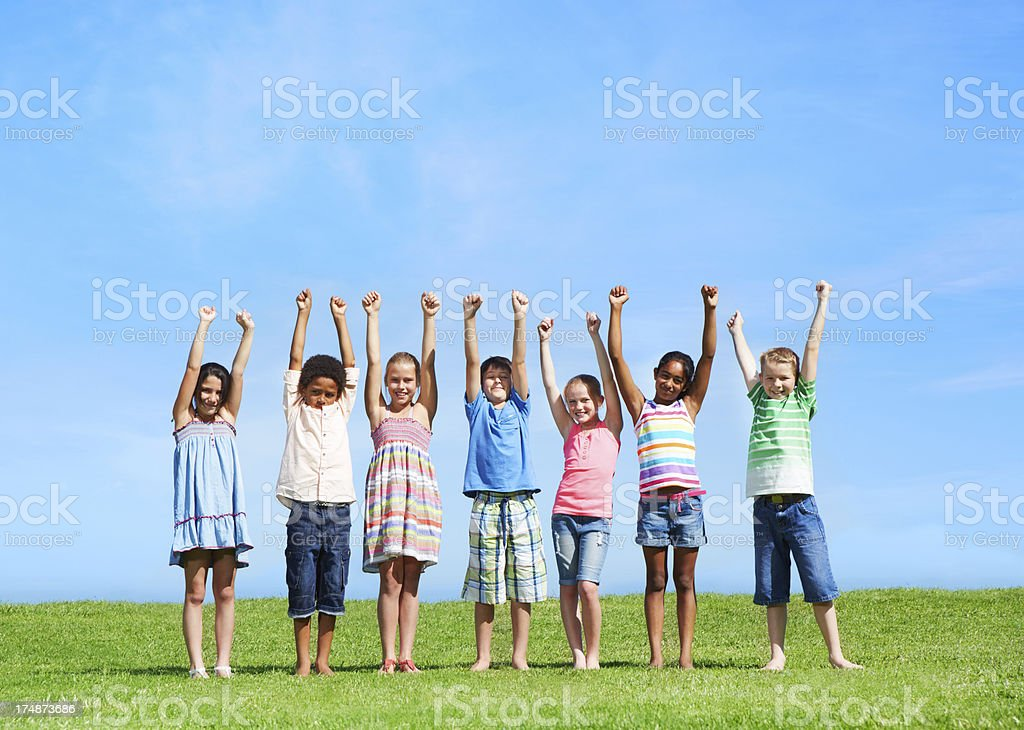 Raising their hands together royalty-free stock photo