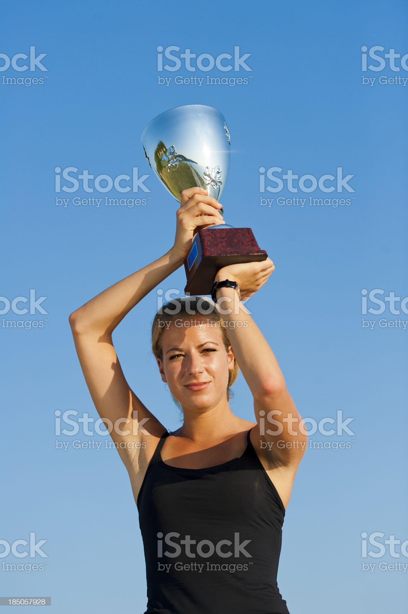 Raising trophy cup royalty-free stock photo