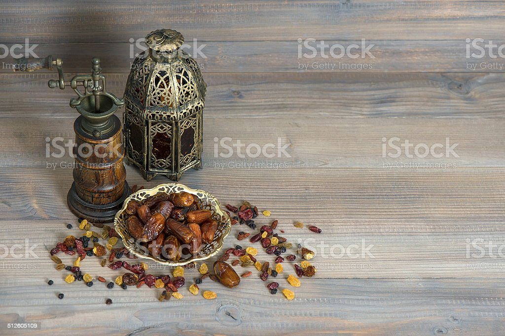 Raisins and dates. Vintage oriental latern and mill stock photo
