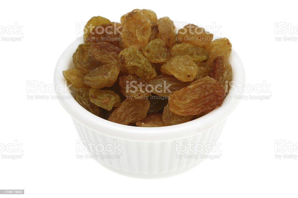 Raisins in a small white bowl royalty-free stock photo