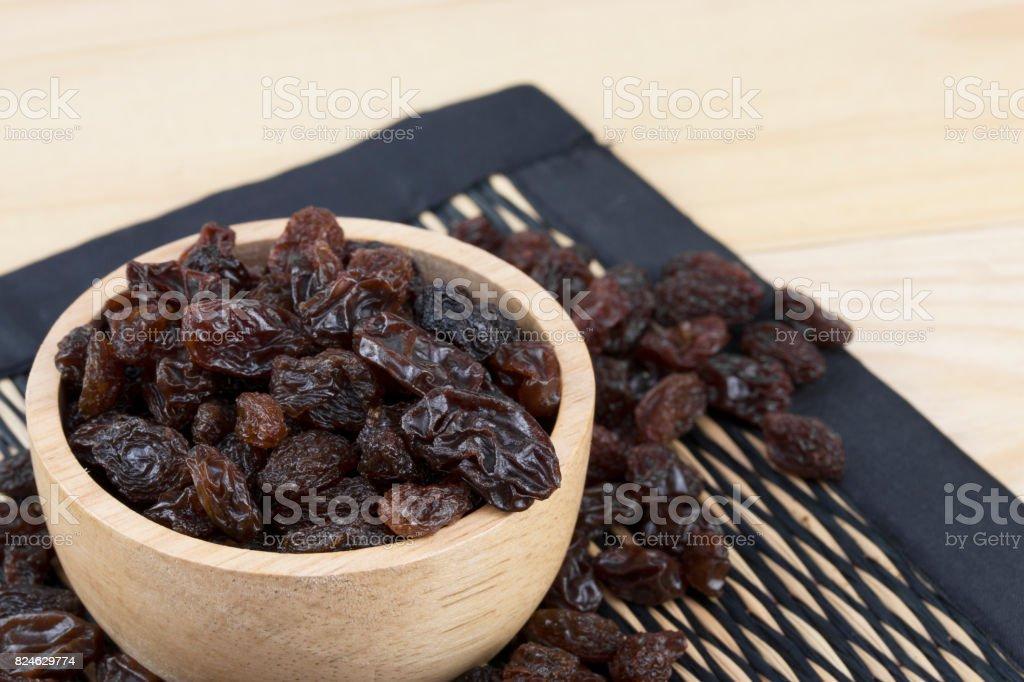 raisins in bowl on table. stock photo