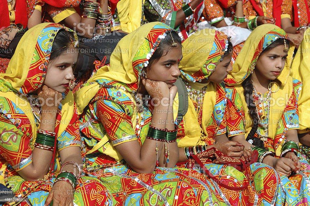 Rajasthani girls are preparing to dance at camel fair,Pushkar royalty-free stock photo