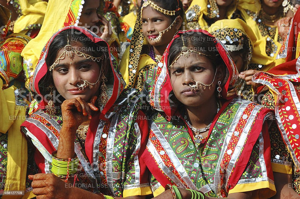 Rajasthani girls are preparing to dance at camel fair,Pushkar royalty-free stock photo