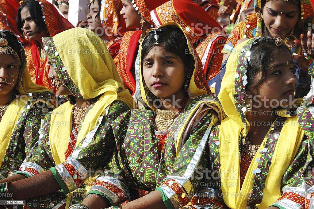 Rajasthani girls are preparing to dance at camel mela,Pushkar royalty-free stock photo