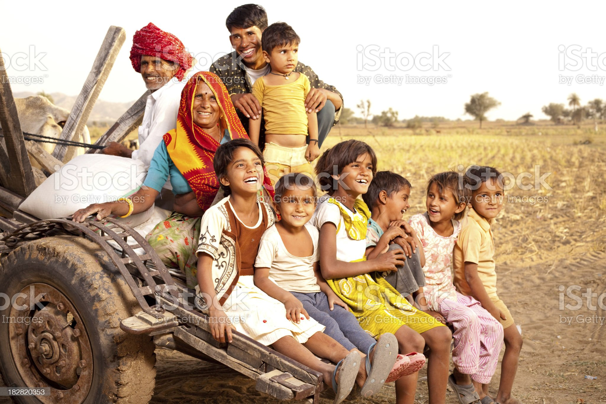 Rajasthani Rural Family enjoying a Bullock Cart Ride in Rajasthan royalty-free stock photo