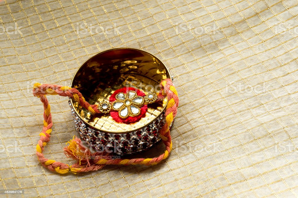 Rakhi kept in a decorated golden box stock photo