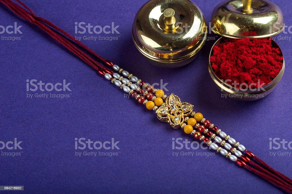 Rakhi or Rakshabandhan Greeting. Rakhi with rice grains and kumkum stock photo