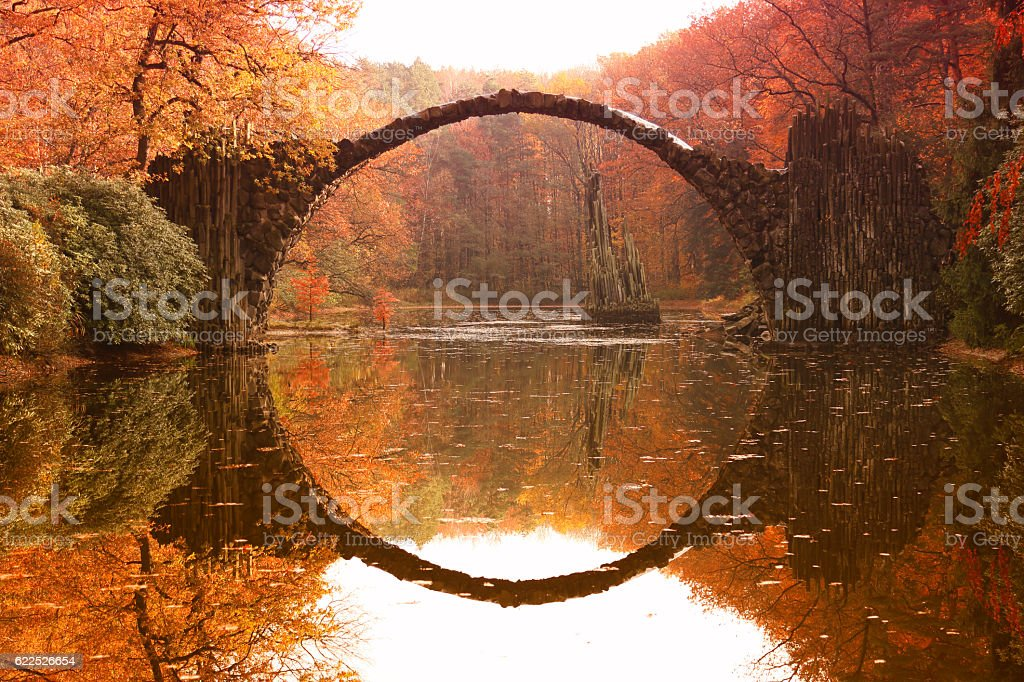 Rakotz bridge (Rakotzbrucke, Devil's Bridge) in Kromlau, Saxony, Germany. Colorful autumn stock photo