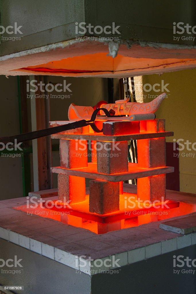 Raku Ceramics Piece in the Fire  - Ceramica  en Horno stock photo