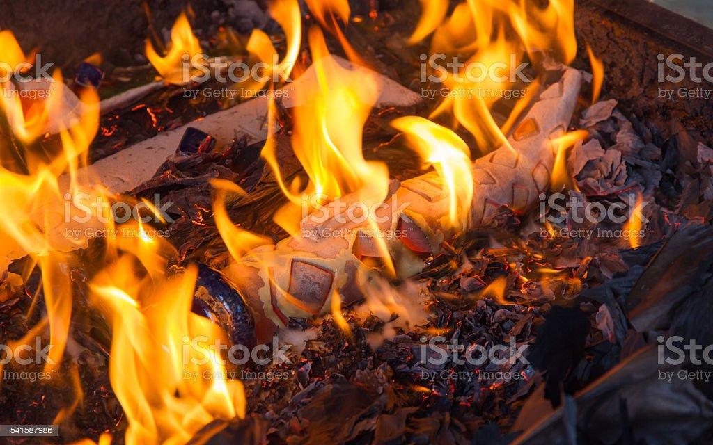 Raku Ceramics Piece in the Fire  - Pieza de Ceramica stock photo