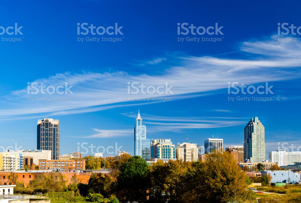 Raleigh Skyline during Autumn With Beautiful Wispy Clouds And Blue Sky stock photo