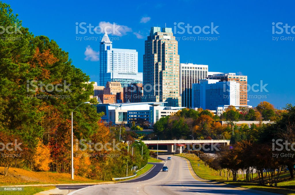 Raleigh Skyline in the distance with autumn colored trees stock photo