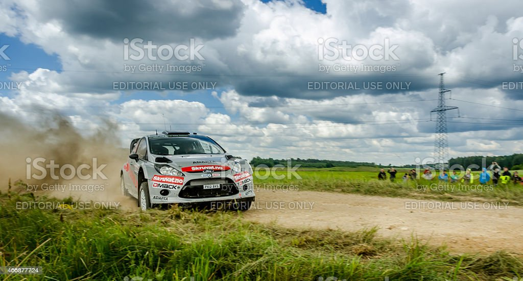 WRC Rally car going sideways on gravel in Lithuania stock photo