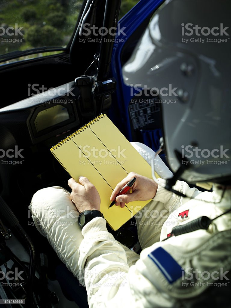 Rally co-pilot writeing note stock photo