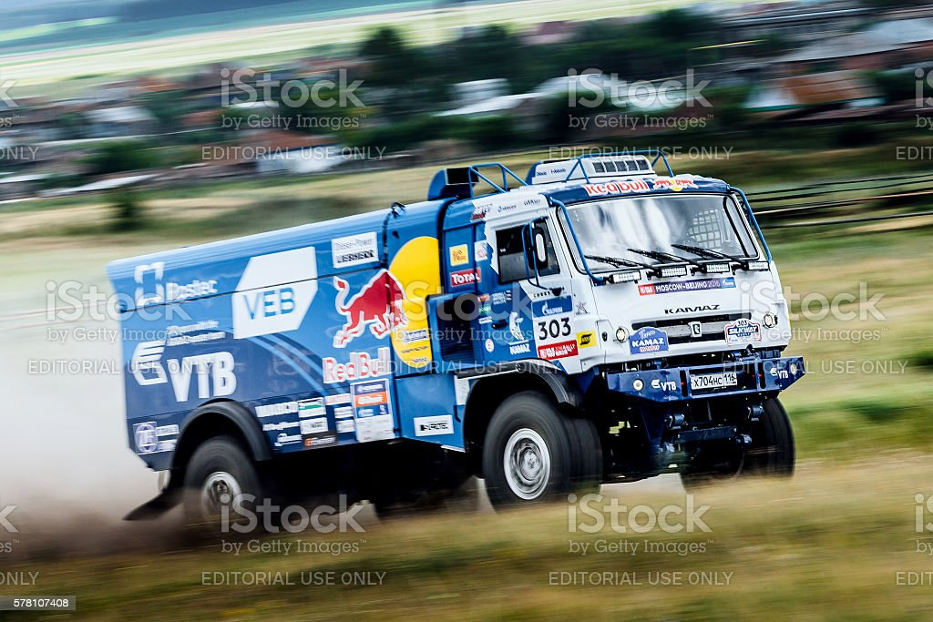 rally KAMAZ truck rides a dusty road royalty-free 스톡 사진