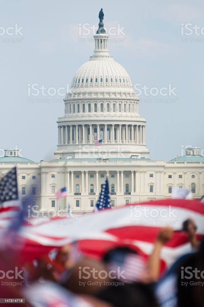 A rally taking place in front of the U.S. Capitol building royalty-free stock photo