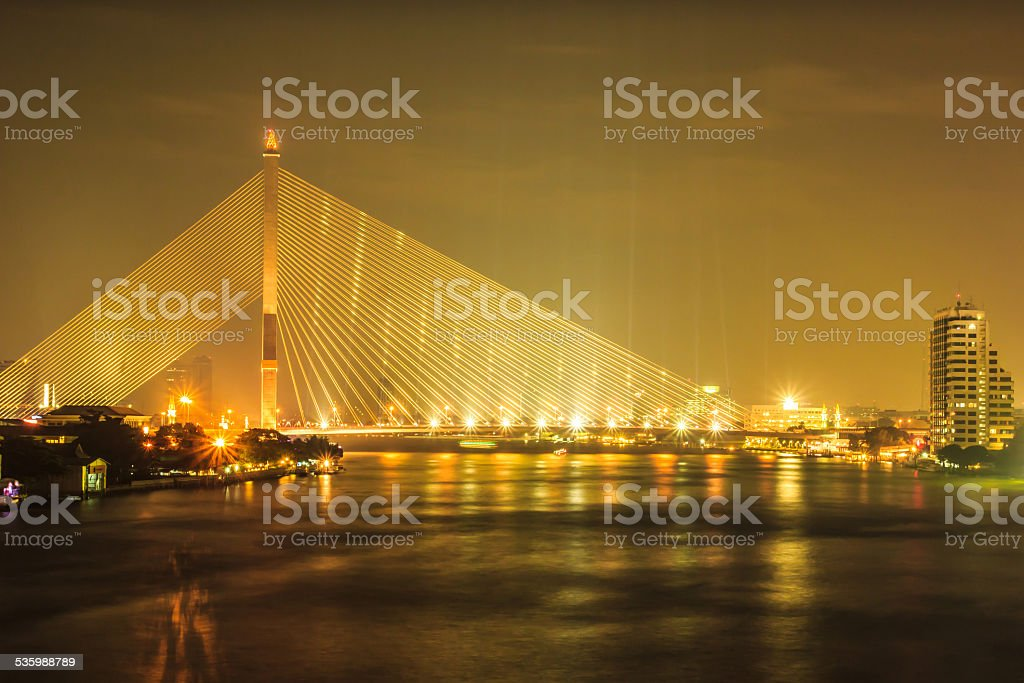 Rama VIII Bridge at night in Bangkok, Thailand stock photo