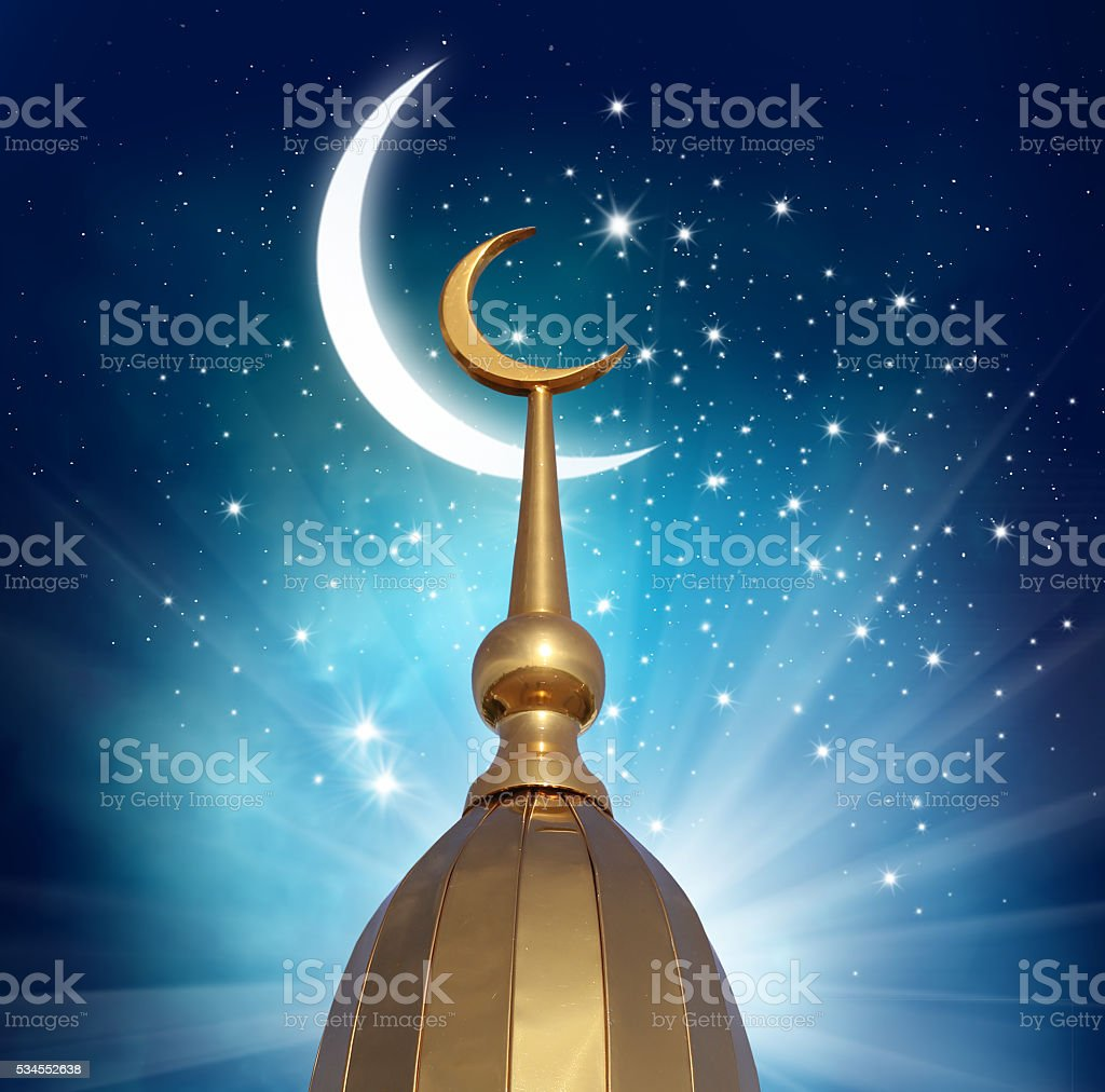 Ramadan Kareem background.Crescent moon at a top of a mosque stock photo
