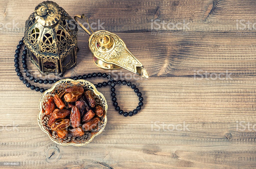 Ramadan lamp, rosary and dates. Holidays decoration stock photo