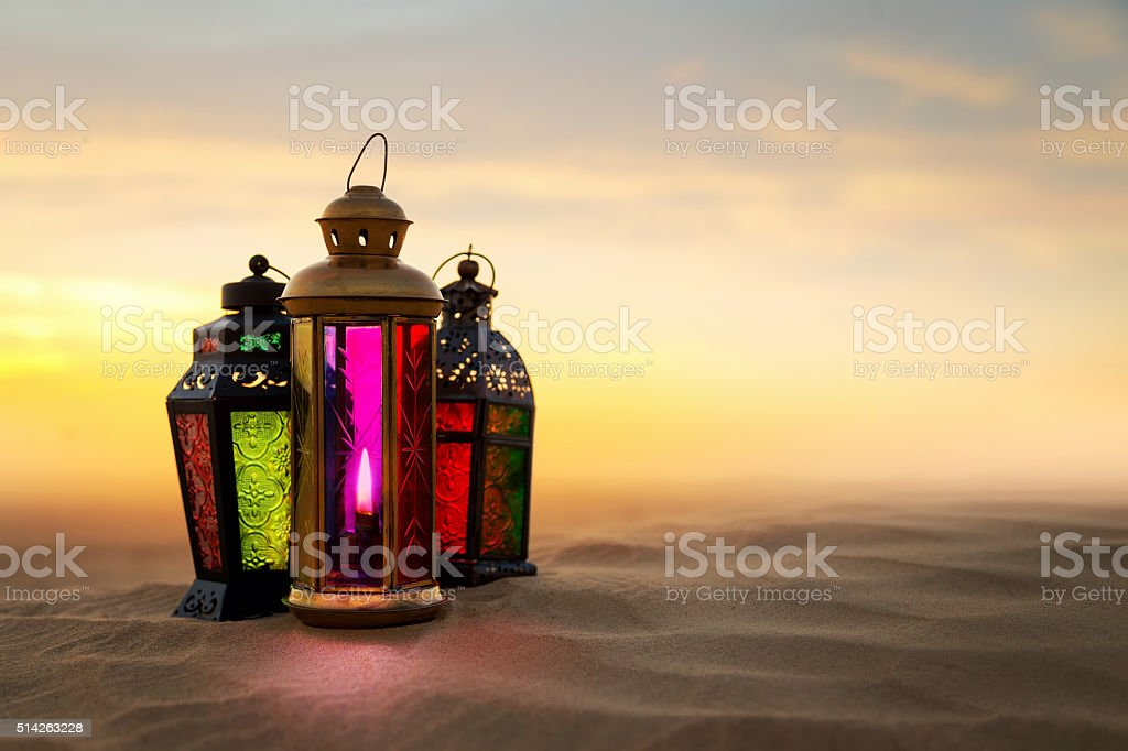Ramadan Lantern on desert Sand dunes stock photo