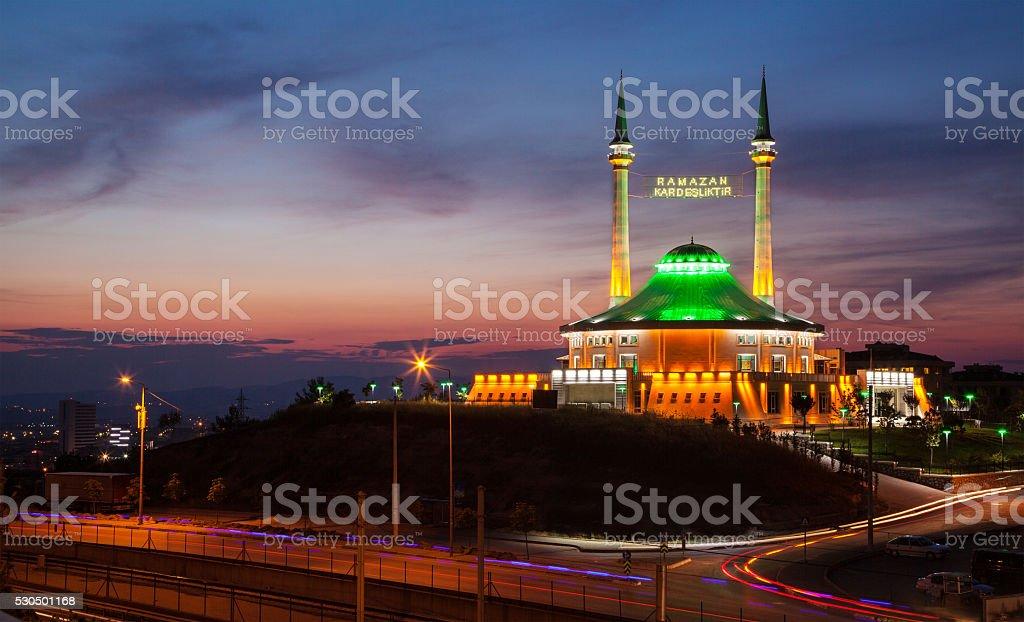 Ramadan Lights between two minarets written 'Ramadan is brotherhood' stock photo