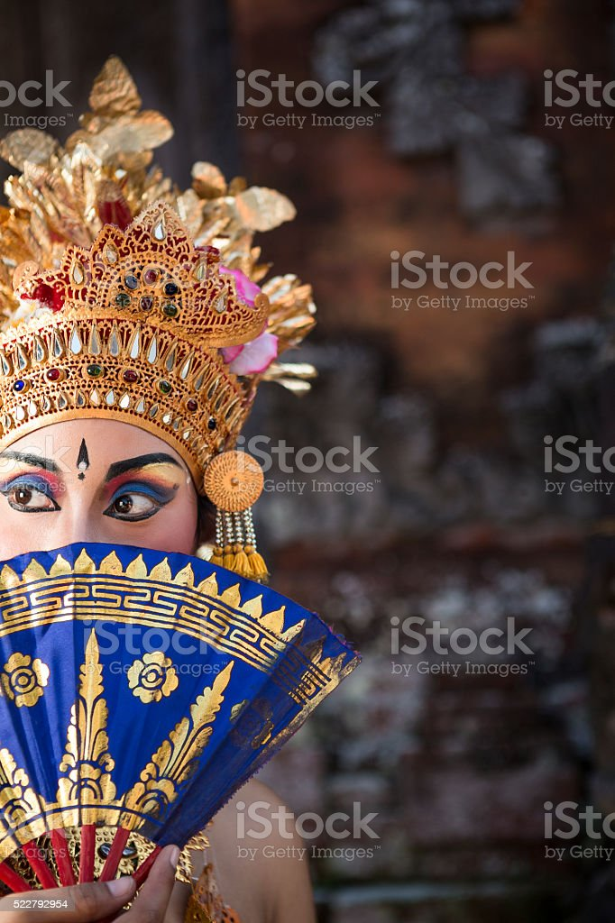 Ramayana Bali dancer with fan in a temple stock photo