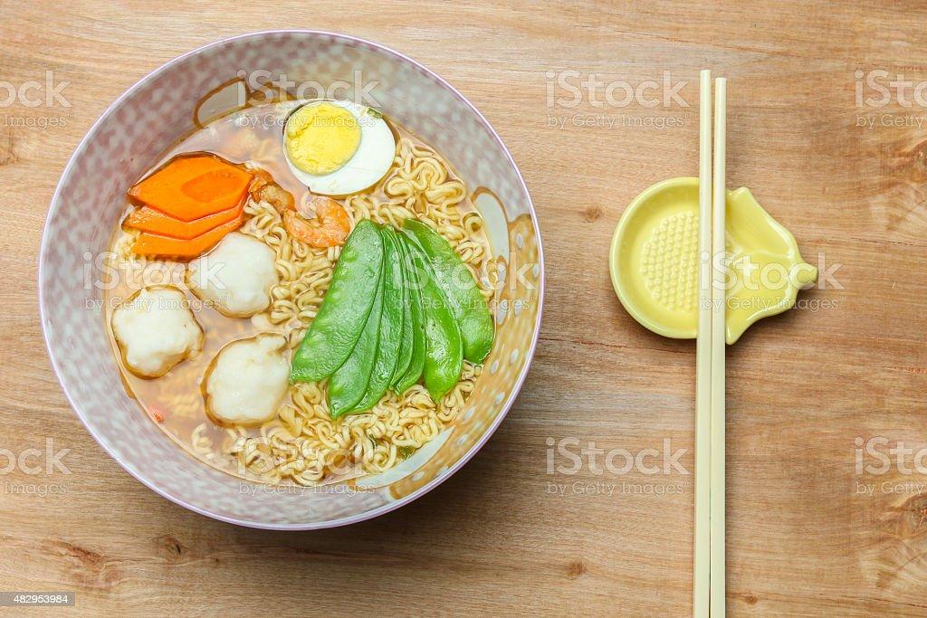 Ramen noodles with egg,fish ball,carrot,snow peas stock photo