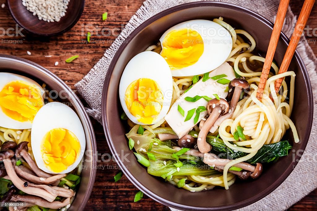 Ramen noodles with eggs, tofu and mushrooms stock photo