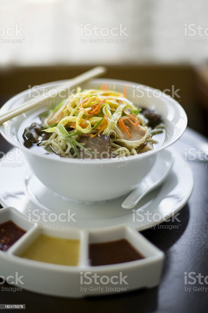 Ramen noodles with many toppings and condiments royalty-free stock photo