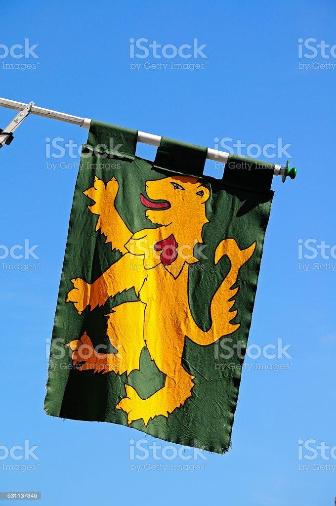 Rampant lion Medieval flag. stock photo