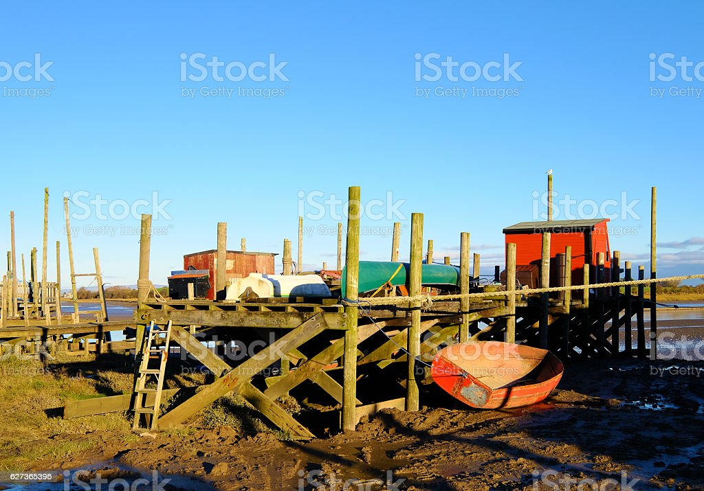 Ramshackle Boatyard on Mudflats stock photo
