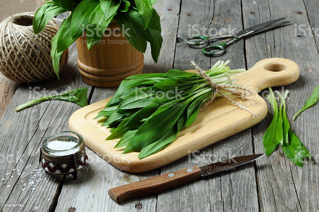 Ramson or wild garlic on a cutting board stock photo