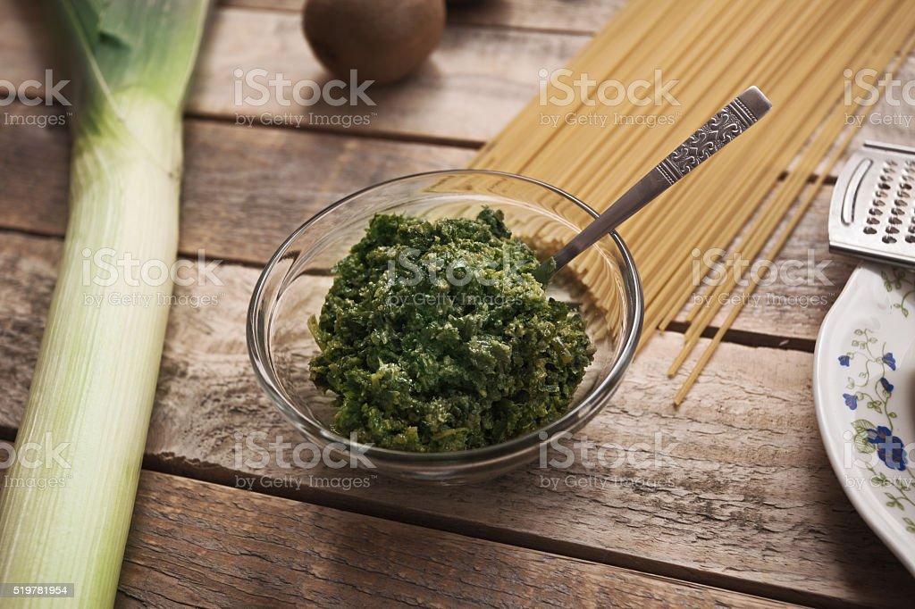 Ramson pesto with spaghetti and leek stock photo