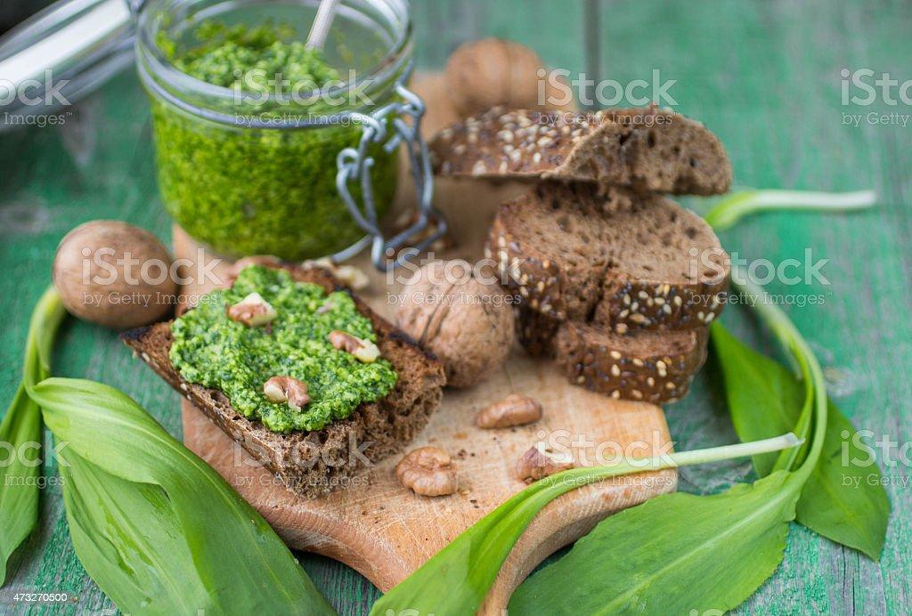 Ramson, wild garlic and sauce pesto on a wooden table stock photo
