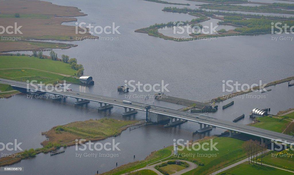 Ramspolbridge and storm barrier with IJssel delta in the backgro stock photo