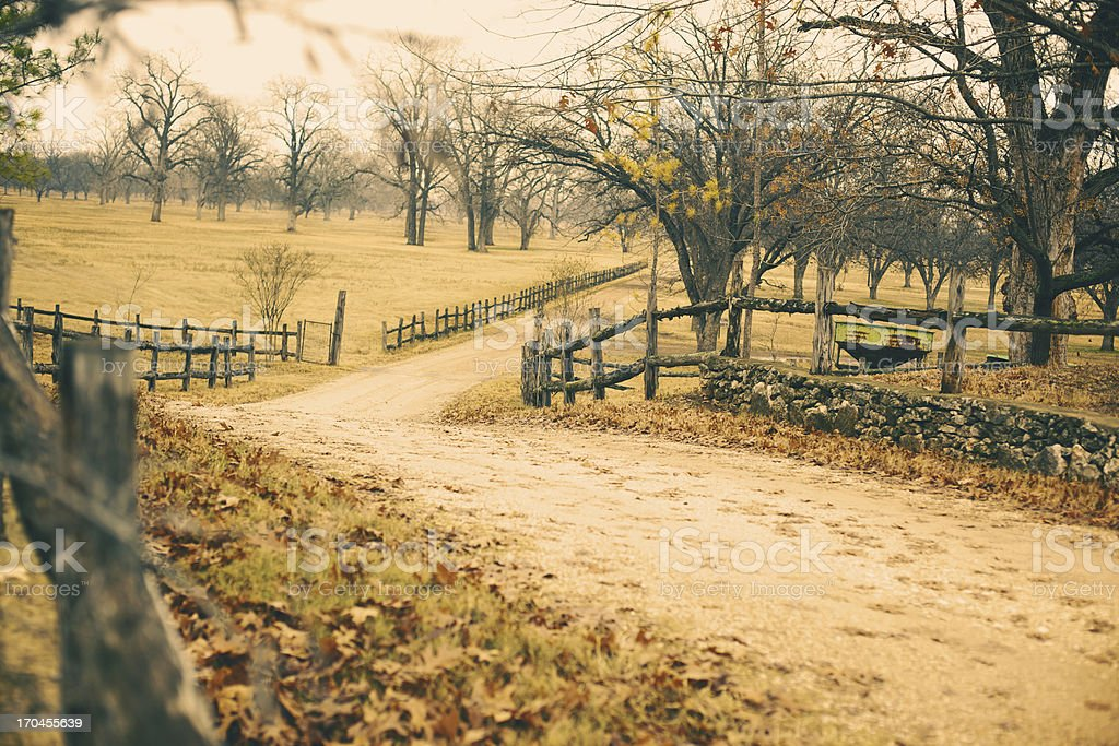 Ranch Dirt Road and Split Rail Fence Overcast Sky royalty-free stock photo