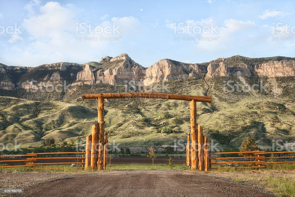 Ranch gate and cliffs in Wyoming, USA stock photo