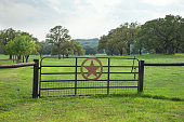 Ranch gate with pasture and trees in Texas Hill Country