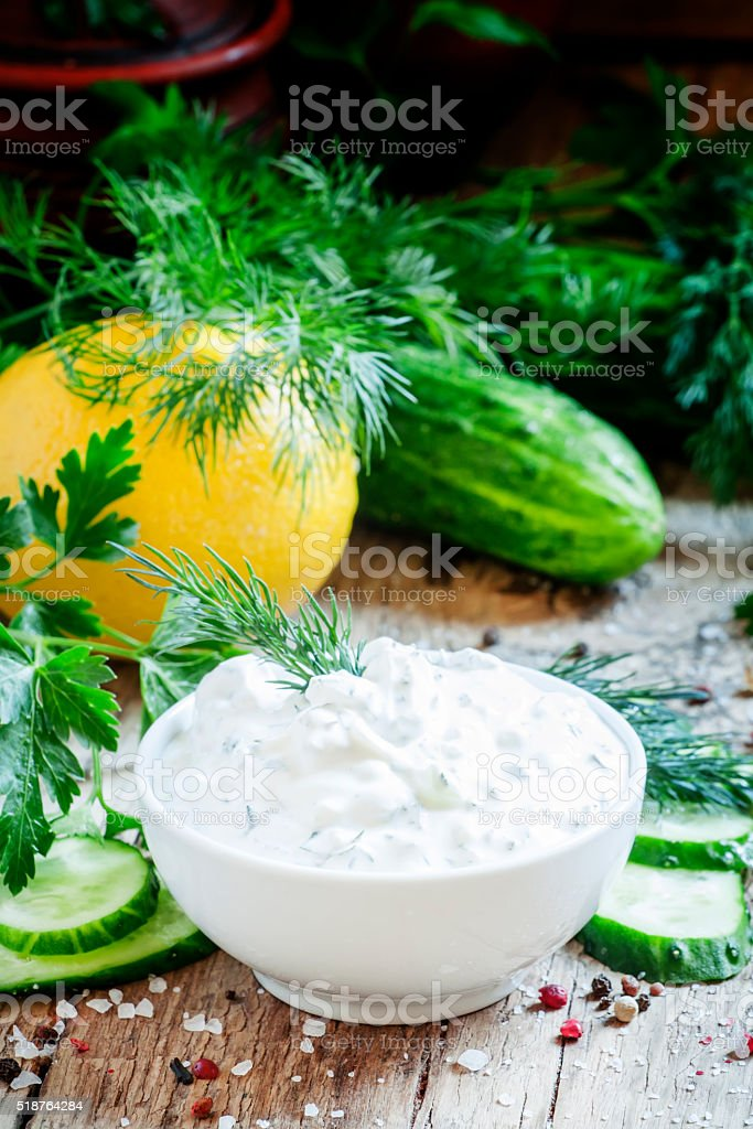 Ranch sauce in a white porcelain bowl with vegetables stock photo