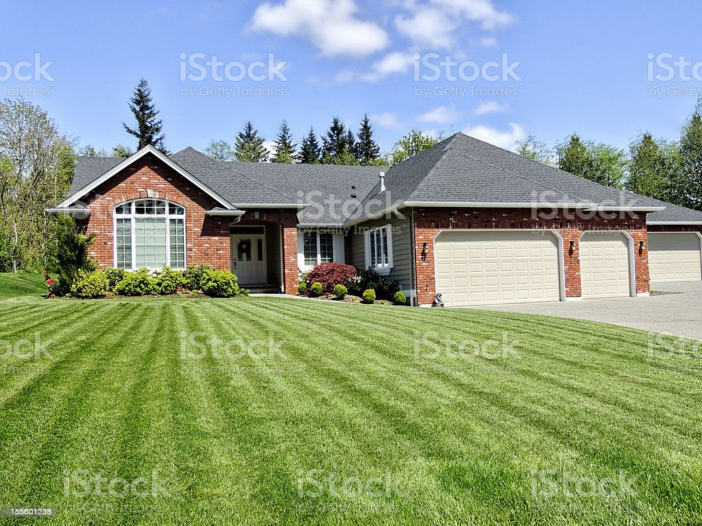 Ranch Style home with a perfect lawn stock photo