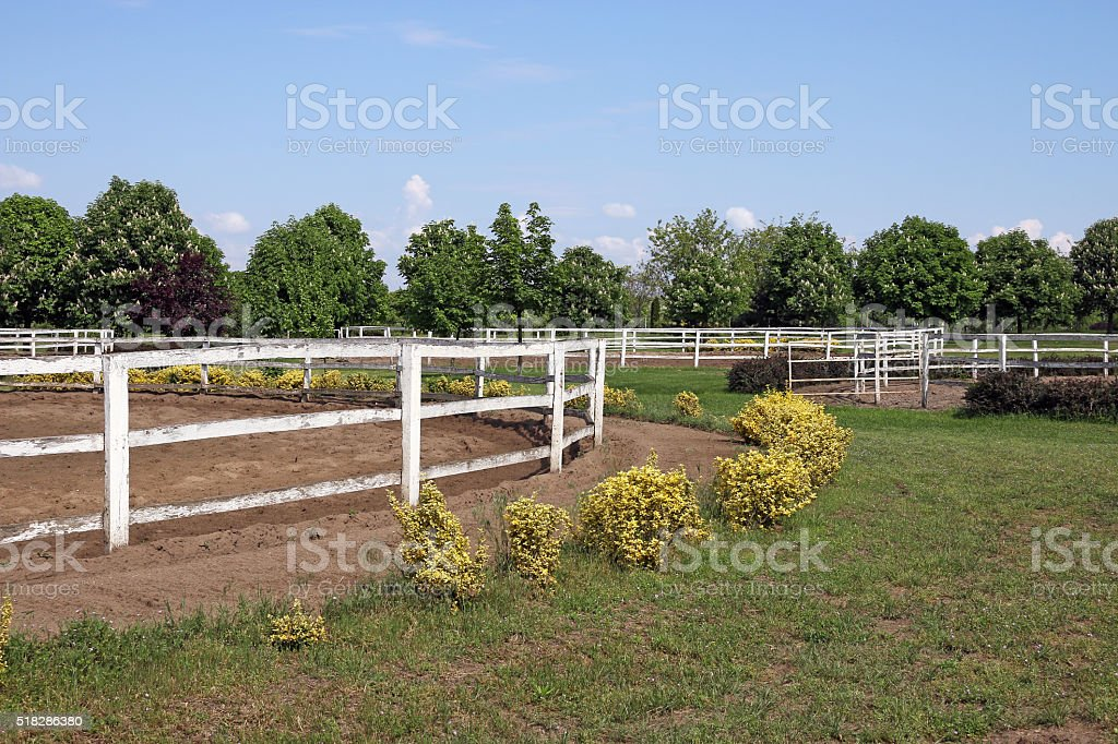 ranch with white corral for horses stock photo